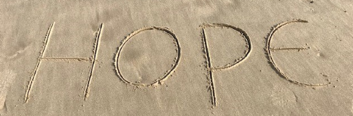 Beach with the word Hope written in the sand